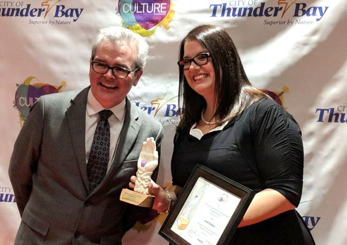 Thom Currie Artist Director of Magnus Threatre presents Candi Badanai with Stage Performance award Lake Superior News