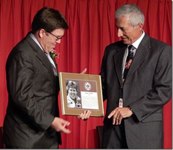 John Jones receiving plaque from Dave Siciliano    Lake Superior News